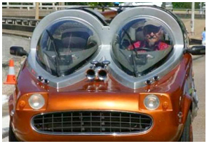 "2004: An early, ill-fated attempt at creating a Giantmobile for our reporters to travel in. We were going to call it the ""Tesla"", but en route to a press conference with Madonna accidentally obliterated two entire blocks of Manhattan, and shelved the project, leaving the plans for our electric-run Giantmobile with some kid called Musk or something. (Company founder Lance Melrose is pictured, driving, second seat from the left)"